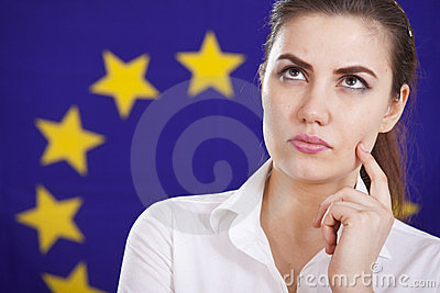 Thinking woman over european flag