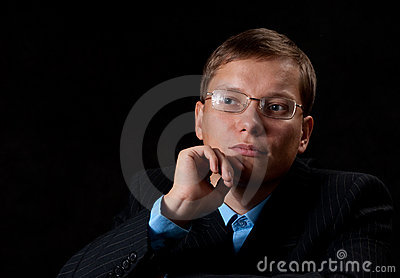 Thinking young businessman