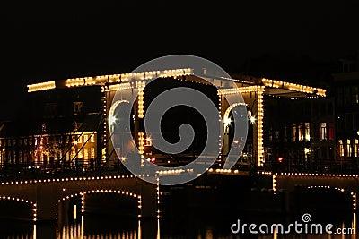Thiny bridge in Amsterdam by night