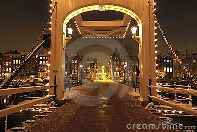 Thiny bridge by night in Amsterdam Netherlands