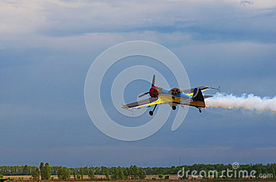 Third AirFestival at Chaika airfield. A small sports plane flies at a low altitude Stock Photo