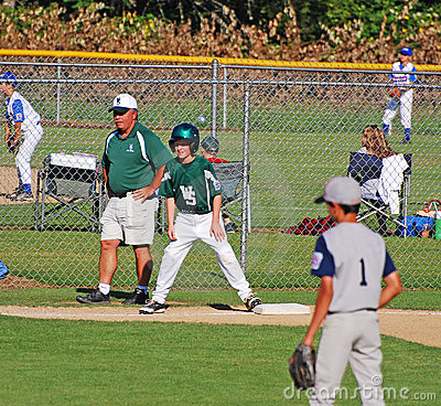 Third base coach. with boy on base. Editorial Stock Image