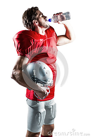 Free Thirsty American Football Player In Red Jersey Drinking Water Royalty Free Stock Images - 60531759