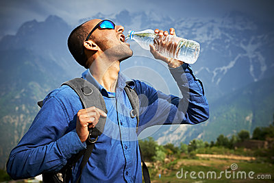 Thirsty tourist drink a water