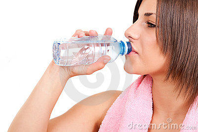 Thirsty woman drinking water