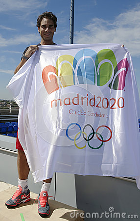 Thirteen  times Grand Slam champion Rafael Nadal holding Madrid 2020 Summer Olympic flag Editorial Stock Image