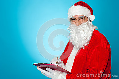 A thoroughly modern Santa claus checks his list