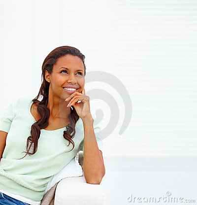 Thoughtful African American female looking away
