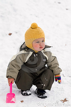 Thoughtful baby with shovel