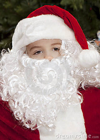 Thoughtful Boy Dressed as Santa Claus