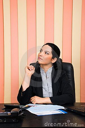 Thoughtful business woman looking away