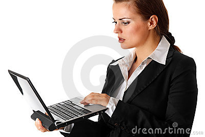 Thoughtful business woman looks in laptops screen