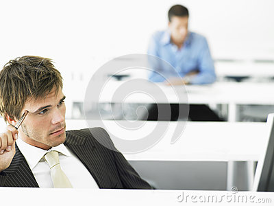 Thoughtful Businessman At Computer Desk
