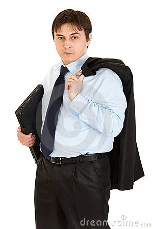 Thoughtful businessman holding folder in hand