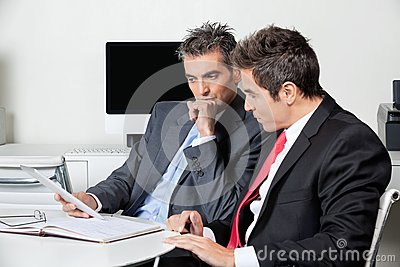Thoughtful Businessmen Using Digital Tablet At