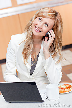 Thoughtful businesswoman on the phone at break