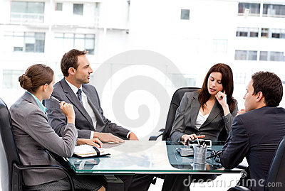 Thoughtful businesswoman talking to her team