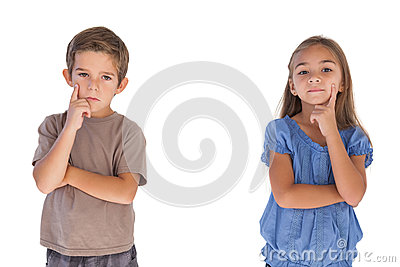 Thoughtful children standing with arms crossed