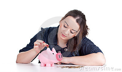 Thoughtful fat girl with piggy bank