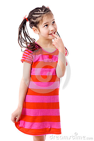 Thoughtful girl in pink dress