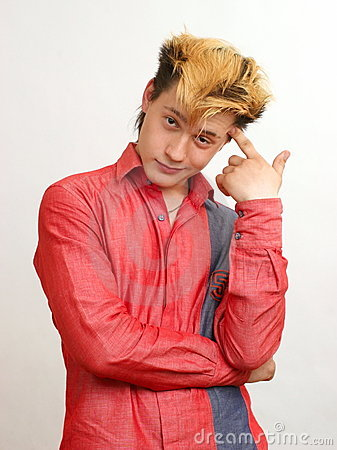 Free Thoughtful Guy With Golden Hairstyle In The Red Stock Images - 8320114