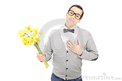 Thoughtful man holding a bunch of flowers