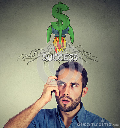 Free Thoughtful Man Looking Up At Rocket Dollar Sign Above Head Stock Image - 92801511
