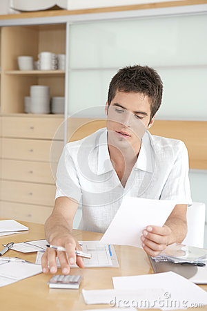 Thoughtful Man Working on Finances