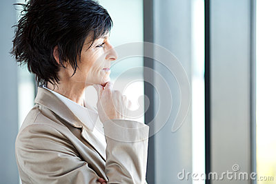 Thoughtful middle aged businesswoman
