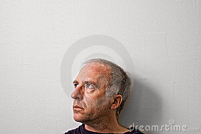 Thoughtful middle aged man