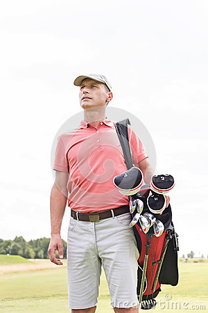 Free Thoughtful Middle-aged Man Looking Away While Carrying Golf Bag Against Clear Sky Stock Images - 85300674
