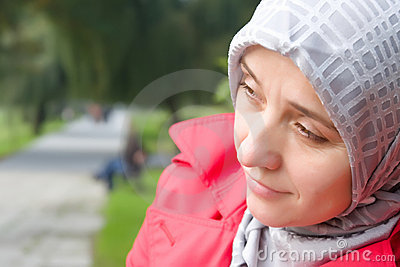Thoughtful muslim woman