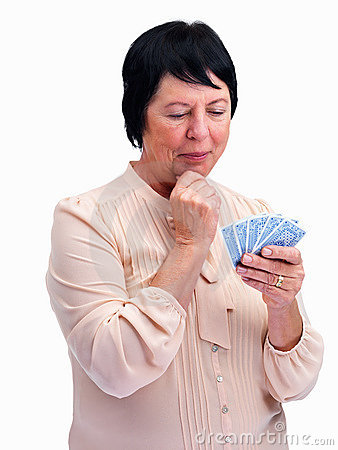 Thoughtful old woman playing cards