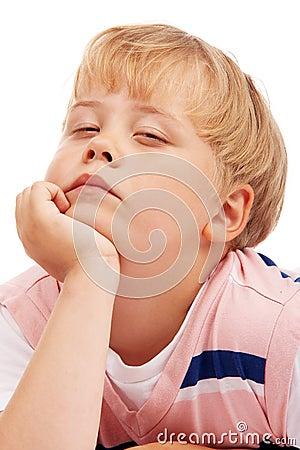 Thoughtful preschooler boy