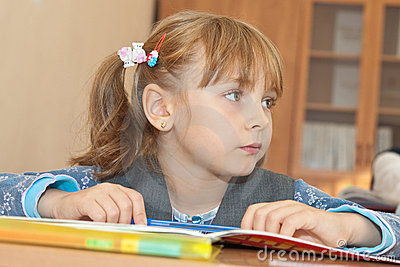 Thoughtful schoolgirl in classroom