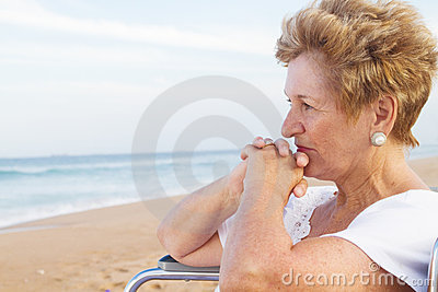 Thoughtful senior disabled woman