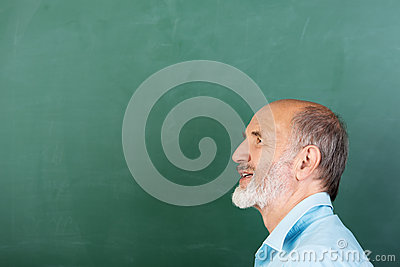 Thoughtful senior male teacher
