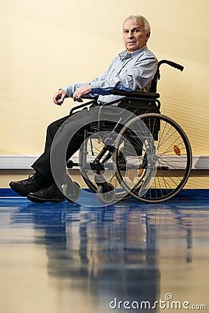 Thoughtful senior man in wheelchair