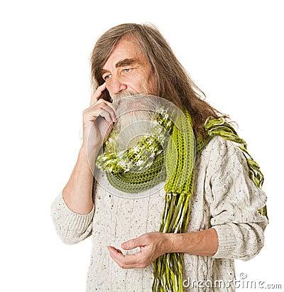 Thoughtful Senior old man. Long hair, mustache, beard