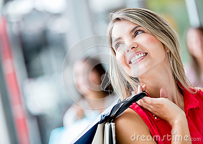 Thoughtful shopping woman