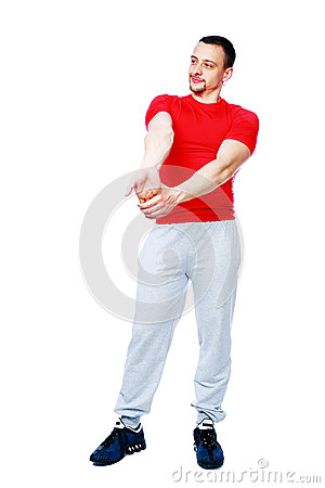 Thoughtful sportsman stretching arms