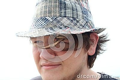 Thoughtful Teen Boy in Plaid Hat