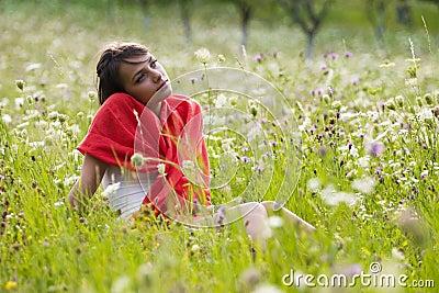Thoughtful woman in field