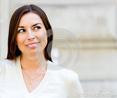 Thoughtful woman smiling