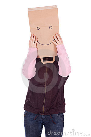 Thoughtful woman in smiling paper bag on head