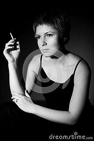 Thoughtful woman smoking