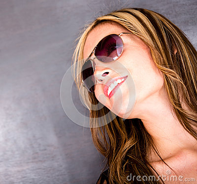 Thoughtful woman wearing sunglasses