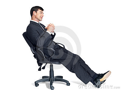Thoughtful young businessman sitting on office cha