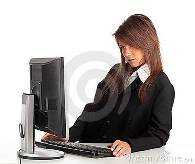 Thoughtful young businesswoman with computer