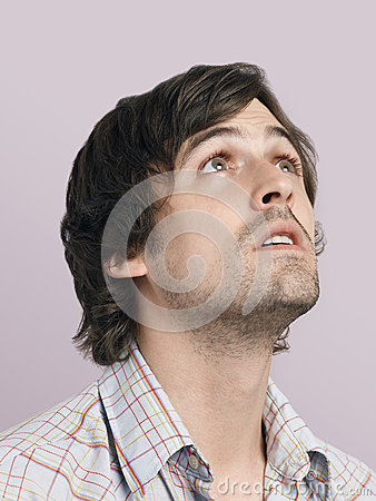 Free Thoughtful Young Man Looking Up Royalty Free Stock Photo - 33910625